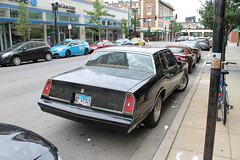 Missing Identification (Flint Foto Factory) Tags: chicago illinois urban city summer august 2017 north edgewater bryn mawr historic district sunday morning beach apartments 7eleven francescas italian restaurant 1981 1982 1983 1984 1985 chevrolet chevy monte carlo darth vader custom grille wheels sooc straight out camera general motors gm gbody platform intermediate midsize personal luxury car front threequarter view black color street parking sidewalk chase bank straightoutof winthrop intersection subway ridge