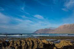 My Girl and the Sea (thelastsonofkrypton89) Tags: lava beach lanzarote canary island holidays landscape ocean sea girl mountains clff nikon d7200