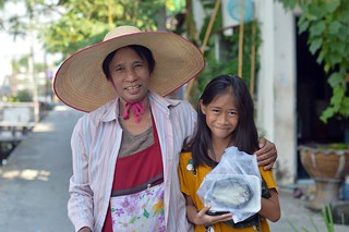 food vendor lady with young customer