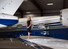 Private jet service, nonstop. (nevadoyerupaja) Tags: female portrait aircraft nikon airplane jet travel black dress barefoot wing hangar pocketwizard speedlight strobes flash sb700 aviation