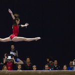 Leaping Gymnast Above the Balance Beam thumbnail