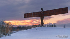 Sledging under the Angel ... (Mike Ridley.) Tags: angelofthenorth snow beastfromtheeast snowstorm sunset sonya7r2 mikeridley nature colour winter cold