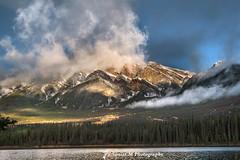 Smoking Mountains (Sònia CM) Tags: landscape longexposure largaexposicion llargaexposicio lumix lumixfz2000 lumixfz2500 lake canada rockymountains water waterscape clouds cloudy mountains