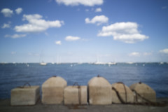Anchors and the Lake (Sean Anderson Media) Tags: concrete anchors concreteblocks horizon lake lakemichigan sailboats boats landscape pinhole pinholelens pinholephotography lofi lofiphotography homemadelens faded lakeside chicago sonya7s bodycap water summer blurry outoffocus waterside vintage retro