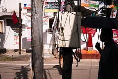ind-7283 (Ed Peters 286) Tags: 2015 fortcochin india kerala advertisementscommunistsymbols hammerandsickle shadows streetscene