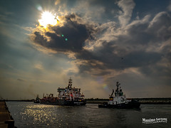 The Ship and the Tugboat (Massimo Saviotti) Tags: flickr awesome camera dmcg6 lumix lumixgvario14140 mft massimosaviotti microfourthird mirrorless panasonic saviottimassimophotography acqua backlight barche beautiful bello best bestphoto bestshot boat bombomachides cirri cloud clouds controluce cumuli fantastic fantastico fineart good great hydraulic idraulica landscape landscapes magnifico mare nave navi nembi nuvola nuvole paesaggi paesaggio panorama sea ship sightseen vista water