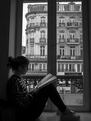 l'étudiante... (objet introuvable) Tags: blackandwhite bw noiretblanc nb study book reading town lille livre urban lumixgx8 lumix panasonic fenêtre window street streetview shadow ombre light lumière