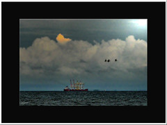 Impressionist vessel (agphoto100) Tags: boat ship vessel canon a710is bay sea water rigging clouds light dark rough frame framed sun black