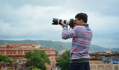 A young tourist taking pictures cityscape (phuong.sg@gmail.com) Tags: aerial architecture asia asian brick building castle chateau city cloudy colorful day destination famous historic historical hot hotel iconic india jaipur landmark male man old overlook park people person photographer pictures railing rain rajasthan sightseeing summer taking tourism tourist town travel urban view young