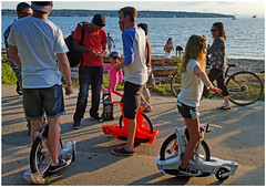 Beachlife (HereInVancouver) Tags: candid streetphotography people outdoors seawall vancouverswestend children toys bicycle unicycle ocean pacific water beach englishbay thingstodobythewater canong16 vancouver bc canada