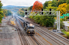 A Smoky Entrance (Wheelnrail) Tags: ns norfolk southern pittsburgh line altoona pennsylvania emd sd60m coal train trains smoke brake shoes fall autumn color city mountain allegheny signal bridge locomotive