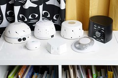 Group of white noise machines on book shelf (yourbestdigs) Tags: white noise machine electric digital analog electronic plug sound dampening reduction quiet privacy sleep aid sleeping bedtime bed sleeps quieter reducer bedroom kids kid dials switch conditioner ambience peaceful bedside beds night time peace silent silence fan ear plugs soothe soothing calm calming