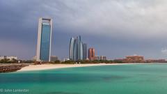 Threat of rain on Abu Dhabi skyline (Jhopne) Tags: corniche uae babalqasr cloud abudhabi canonef2470mmf28lusm sky cityscape etihadtowers canoneos5dmarkii adnoctower mar18 city architecture towers building skyline bay sea water overcast