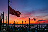 Venetian Flag (fentonphotography) Tags: venice italy wingedlion flag sunrise colorful lamps gondola water horizon windblown