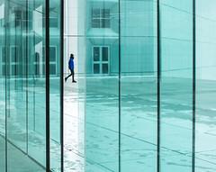 People in glass houses... (EyeOfTheLika) Tags: ifttt 500px symmetrical modern architecture minimal glass wall geometry walkway street lika lines man walking candid art
