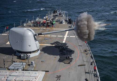 USS Ross fires its 5-inch gun during a live fire exercise.