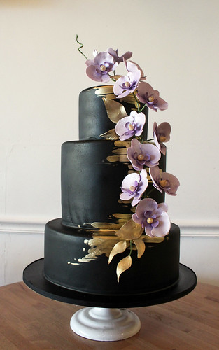 Modern Black with Gold and Orchid Spray Wedding Cake