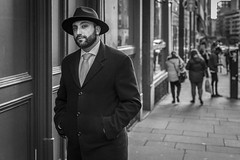The City Street (Leanne Boulton) Tags: people urban street candid portrait portraiture streetphotography candidstreetphotography candidportrait streetportrait streetlife eyecontact candideyecontact man male face eyes expression look emotion mood atmosphere feeling hat beard style stylish fashion coat tie tone texture detail depthoffield bokeh naturallight outdoor light shade shadow city scene human life living humanity society culture canon canon5d 5dmkiii 50mm primelens ef50mmf14usm black white blackwhite bw mono blackandwhite monochrome glasgow scotland uk
