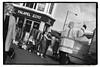 BACKING UP, ON PORTOBELLO ROAD (StockCarPete) Tags: bw london waving people hugging uk falafel portobelloroad shop stall