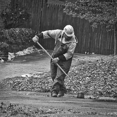 Sweeping up (btusdin) Tags: 7daysofshooting week27 banginthemiddle blackandwhitewednesday street broom hardhat wssc streetrepair