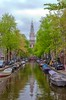 canal view (brian@bletchingley) Tags: barges house boats amsterdam canal trees tower water reflection holland netherlands