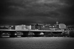 Dark Town (delmarvajim) Tags: bw blackandwhite city bridge storm river darkdrama architecture fineart