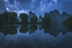 Early morning... (Syahrel Azha Hashim) Tags: tranquil nikon calm reflection mountains tokina shallow early nopeople simple trees details dramaticsky ultrawideangle symmetric guilin getaway stream colorimage vacation holiday china clouds mountain naturallight dof bluehour handheld beautiful travel syahrel d300s liriver colors river light colorful morning detail