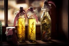 bottles of light (mad_airbrush) Tags: 5d 5dmarkiii bottles light yellow österreich austria alm 135mm ef135mmf2lusm stilllife stillleben kräuter flaschen