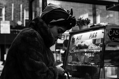 lady in fur in Brick Lane Beigel Shop (Joel_Goldstein) Tags: london street life candid documentary brick lane beigel black white bnw noiretblanc high contrast lady fur coat portrait profile retrato sony a7 dof