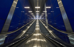 upwards in the blue (Blende1.8) Tags: bleu blau rolltreppe escalator ubahn metro underground architecture architektur lines line symmetry symmetrie lights light wideangle sony alpha ilce7rm2 a7rm2 a7rii 224mm perspective carstenheyer düsseldorf duesseldorf blue