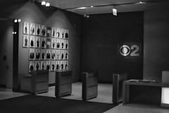 Now Playing at CBS2.jpg (Milosh Kosanovich) Tags: vintagefilm epsonv750pro chicagophotoart chicagophotographicart chicago kodaktmaxrsdeveloper mickchgo miloshkosanovich cbs2lobby kodaktmax100 bwfilm minoltax700 chicagophotographicartscom film cbseye