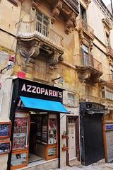 Azzopardi's (Douguerreotype) Tags: street city urban shop balcony buildings malta architecture valletta sign door store