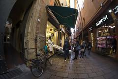 """Bologna (Italy) - Il """"quadrilatero"""" - Via Drapperie (Massimo Battesini) Tags: bologna emiliaromagna italia it fujifilmxe1 fuji xe1 fujixe1 fujifilm finepix samyang8mm28 samyang8mm28fisheye fisheye samyang market marché mercato bazar bazaar bicicletta vélo bicycle biciclettes bicicletas biciclette bike bikes centrostorico zentrum centreville centromedievale centremédiéval medievalcenter centromedieval città ville city stadt town ciudad photographiederue streetphotography fotografiaderua photosdelavie escenacallejera ilquadrilatero viadrapperie italy italie italien europe europa pesce pescheria fish poisson poissons poissonerie"""