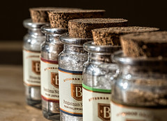 Finishing Salts (docoverachiever) Tags: gourmet shallowdepthoffield macro salt spice cooking corks home kitchen row labels five bottles