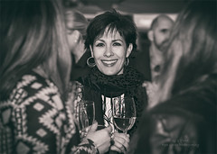 A Face in the Crowd (Red Gecko Photography) Tags: crowds event street face black white monochrome san pedro spain people drinking wine
