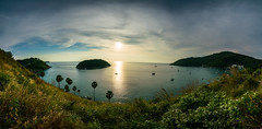Panorama of Promthep Cape viewpoint at Phuket southern of Thailand at sunset. (MongkolChuewong) Tags: amazing andaman asia background beach beautiful best blue cape coast coastline coconut island islands journey landscape light mountain natural nature nobody ocean outdoor palm panorama panoramic phomthep phromthep phuket point promthep relax scenery sea sky summer sunny sunset thai thailand travel traveler traveller tree tropic tropical view viewpoint water wave