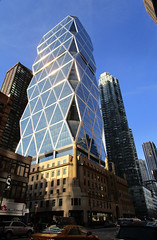 Hearst Building with Modern Glass Tower 57th street 71611 (Brechtbug) Tags: hearst building statues across from 57th street 8th ave new york city caryatid atlantid 2018 nyc 02192018 art architecture gargoyle gargoyles statue sculpture sculptures facade figures column columns stone stones concrete block blocks buildings avenue publishing publisher news paper newspaper deco