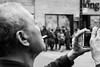 Multitasking (dharder9475) Tags: 2018 5star argylenewyearparade bw blackandwhite cameraphone candid chinesenewyear lunarnewyear man photographer privpublic smoker smoking streetphotographer