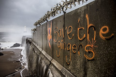 Some fantastic Aberdeen graffiti (colskiguitar) Tags: aberdeen harbour breakwater northeast waves storm pier wild weather lighthouse graffitti bnw monochrome