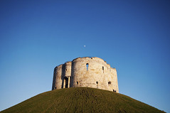 Clifford's Tower, York (sammiecaine) Tags: ©sammie sammiecainephotography nikond5000 york yorkshire england county whiterose cliffordstower yorkcastle castle tower medieval history culture viking vikings sky blue winter spring hill bank minimal minimalism negativespace moon ruins heritage travel britain uk city citywalls nikon sigma wideangle 1020mm