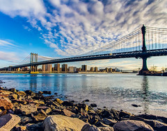 Manhattan Bridge (brianloganphoto) Tags: daytime bridge northamerica water buildings manhattanbridge rocks brooklyn historical transportation eastriver nyc newyorkcity landcape landmark regions steel unitedstates newyork clouds us