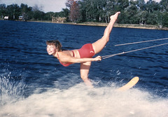 Woman waterskiing during a performance at the Cypress Gardens theme park in Winter Haven (State Library and Archives of Florida) Tags: florida cypressgardens themeparks tourism waterskiing attractions lakeeloise winterhaven womenskiers gardens