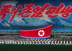 North Korean taekwondo team in front of a giant flag during the Arirang mass games in may day stadium, Pyongan Province, Pyongyang, North Korea (Eric Lafforgue) Tags: adultsonly arirang asia asian asianethnicity cardflipper celebrationevent choregraphy communism dictatorship dprk festival flag horizontal humanfresco illustration img4964 koreanscript largegroupofpeople massgames massmouvement mosaic multicolored nationalflag night nonwesternscript northkorea northkoreaflag northkorean patriotism peopleinarow performing propaganda pyongyang redstar rungrado show sport taekwondo team togetherness unrecognizablepeople pyonganprovince 北朝鮮 북한 朝鮮民主主義人民共和国 조선 coreadelnorte coréedunord coréiadonorte coreiadonorte 조선민주주의인민공화국 เกาหลีเหนือ קוריאההצפונית koreapółnocna koreautara kuzeykore nordkorea північнакорея севернакореја севернакорея severníkorea βόρειακορέα