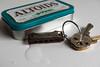 In the key of... (LeftCoastKenny) Tags: utata ironphotographer toy harmonica water turquiose tin keys utata:project=ip258 utata:description=hide
