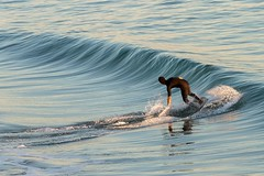 Riding the Wave (Karen_Chappell) Tags: people wave surf surfing surfer usa travel ocean pacific balboabeach orangecounty sea blue waves water california
