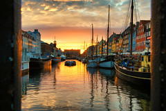 Nyhavn sunset (Pat Charles) Tags: nyhavn copenhagen newharbour newharbor kobenhavn københavn scandinavia europe travel tourism sunset evening water reflection reflected reflections boat boats yacht barge mast sail sailing vessel clouds nikon cafe restaurant bar framed framing orange outside outdoor outdoors 1001nights