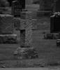 The Old Rugged Cross (John Neziol) Tags: jrneziolphotography portrait outdoor old odd nikon nikondslr nikoncamera nikond80 naturallight monochrome brantford beautiful blackwhite cross ruggedcross mounthopecemetery tombstone headstone cemetery grass