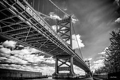 Crossing the Bridge (Igor Danilov Philadelphia) Tags: bridge structure bw mono monochrome philadelphia photo photography igordanilov google search transition railroad septa tracks sky clouds crossing downtown nj up delaware delawareriver pennslanding contrast train nikond700