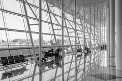Sit and wait (frank_w_aus_l) Tags: porto portugal airport wait bw reflection people geometry fuji x100t bank travel moreira pt city monochrome netb human lines tiles