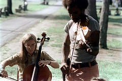 55-267 (ndpa / s. lundeen, archivist) Tags: nick dewolf nickdewolf photographbynickdewolf 1974 1973 1970s color 35mm film 55 reel55 boston massachusetts ma cambridge park common cambridgecommon people youngpeople livemusic musician musicians player players man men youngman youngmen black africanamerican brunette facialhair beard musicalinstrument glasses eyeglasses cello cellist playingacello playingthecello violin violinist playingaviolin playingtheviolinblond blonde longhair